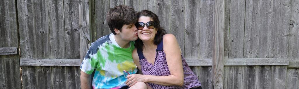 Teenage Son Kissing mum on cheek